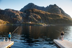Kids fishing for some cod in Senja