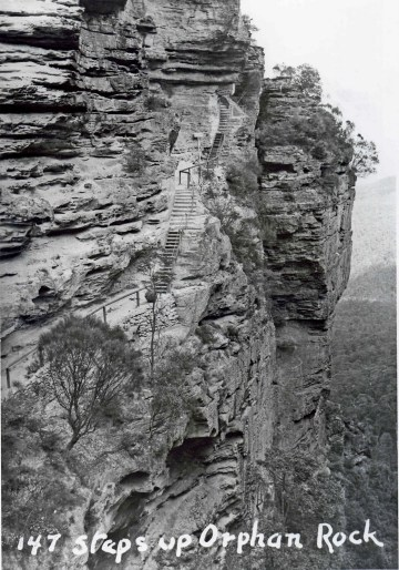 Photo from 1938 showing the stairs up Orphan Rock. Source: http://mntviews.blogspot.com/2011/12/orphan-rock-nsw-australia.html